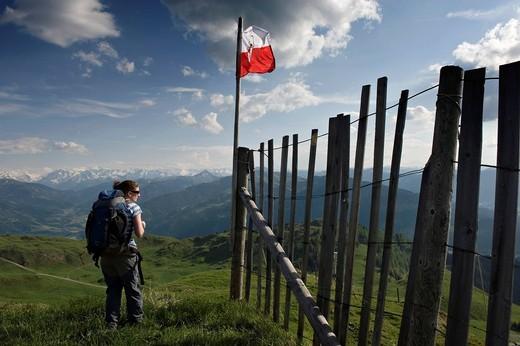 A Female Hiker Enjoys The Panoramic View From The Kitzbuheler Horn. Kitzbuehel. Tyrol. Austria. A Female Hiker Enjoys The Panoramic View From The Kitzbuheler Horn. : Stock Photo