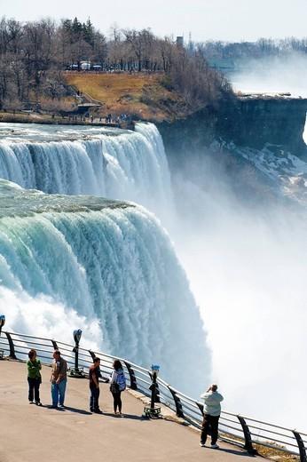 Tourists Enjoying The View Of Niagara Falls, Ontario And New York Border, Canada And United States Of America. Tourists Enjoying The View Of Niagara Falls : Stock Photo