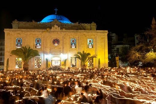 People with lit candles, Easter morning outside Aigos Titos churchHeraklion / Iraklio, Crete, Greece. People with lit candles, Easter morning outside Aigos Titos church : Stock Photo