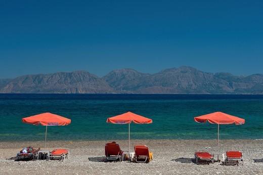 Sun shades on Kitro Platia beach,Gulf of Mirabello, Agios Nikolaos, Crete,. Sun shades on Kitro Platia beach, : Stock Photo