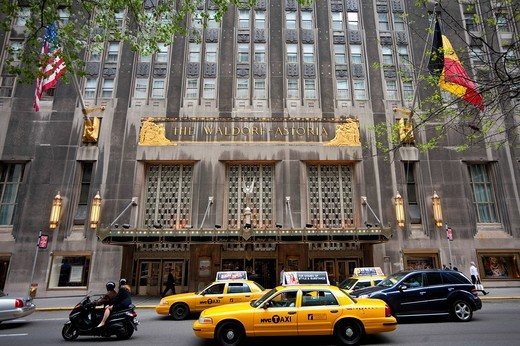 Stock Photo: 1783-32643 Taxis Passing By The Waldorf Astoria Hotel In Midtown Manhattan, Midtown Manhattan, New York, USA. Taxis Passing By The Waldorf Astoria Hotel In Midtown Manhattan