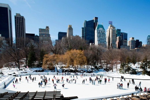 Stock Photo: 1783-32682 Tilt shift image of skaters on pond at the southern end of Central ParkNew York. USA. Tilt shift image of skaters on pond at the southern end of Central Park