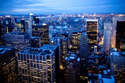Tilt shift evening image of Manhattan from the top of the Rockefeller centre,Rockefeller centre, New York. USA. Tilt shift evening image of Manhattan from the top of the Rockefeller centre, : Stock Photo