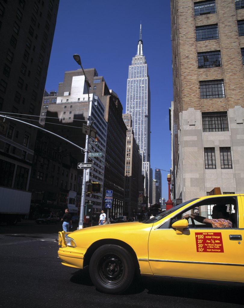 Stock Photo: 1783-3492 Yellow taxi cab and Empire State Building, New York City, NYC.