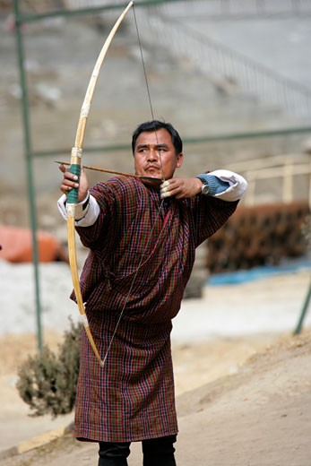 Stock Photo: 1783-3611 Man aiming with longbow, Thimphu, Bhutan