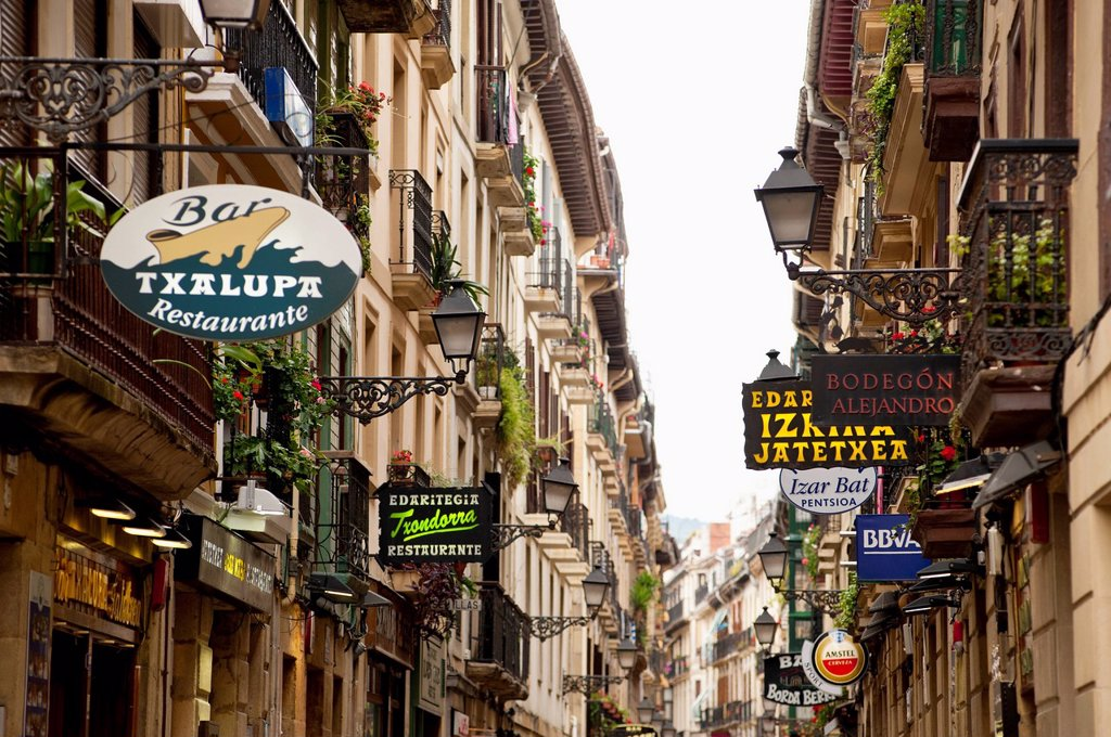 Stock Photo: 1783-36479 Narrow Street With Shop Signs In The Old Quarter, San Sebastian, Basque Country, Spain