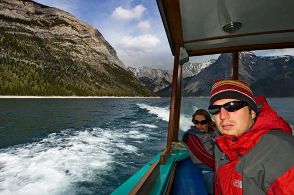 People on a boat tour on Lake Minnewanka, Banff National Park, Alberta, Canada : Stock Photo