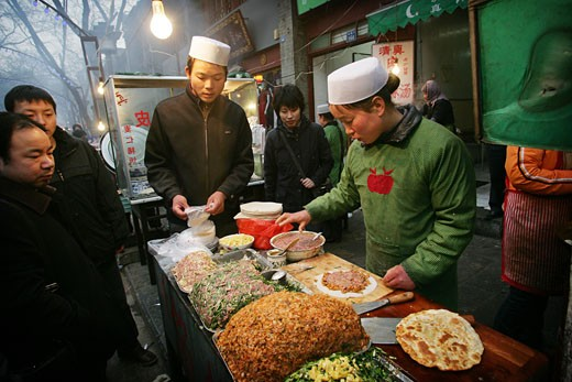 A street stall selling food in the Muslim Quarter, Xian, Xi'an, Capital of Shaanxi Province, China  : Stock Photo