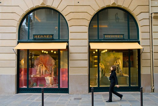 Stock Photo: 1783-4151 Woman walking past the Hermes shop on Rue St Honore, Paris, France