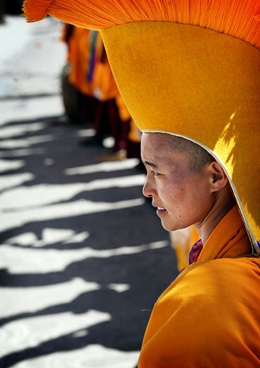 Nuns in traditional dress with yellow orange hats and robes at 800 year old birthday celebration / rituals of the Buddhist Drukpa Lineage, Naro Photang Shey, ( Shey Monastery ), Leh Ladakh, Indian Himalayas, India, Nuns in traditional dress with yellow orange hats and robes at 800 year old birthday  : Stock Photo