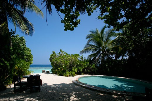 Stock Photo: 1783-5056 Private swimming pool and beach, Soneva Fushi,Northern Atoll,Maldives