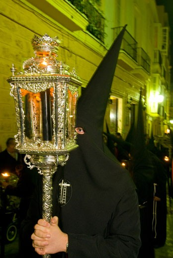 Stock Photo: 1783-5208 Procession of masked hooded priests at Semana Santa Easter festival, Cadiz,Andalucia,Spain