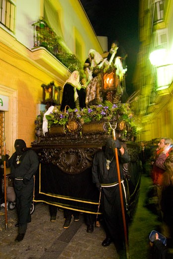 Procession of people carrying 'flota' at Semana Santa Easter festival, Cadiz,Andalucia,Spain : Stock Photo