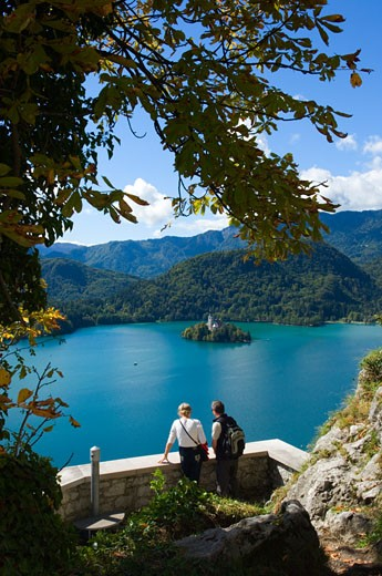 Two tourists looking at Lake Bled from castle, Slovenia : Stock Photo