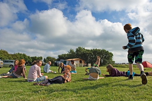 Stock Photo: 1783-5731 Children having fun on a camping holiday , Pevensey Bay, East Sussex, England, United Kingdom