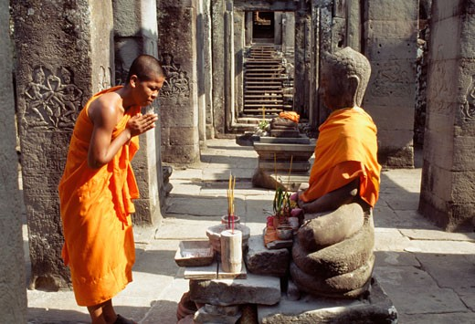 Stock Photo: 1783-6304 Monk praying in the Preah Khan Temple,  Siem Reap, Cambodia