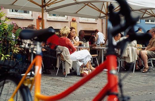 Bicycle and people in restaurants,  Copenhagen, Denmark : Stock Photo
