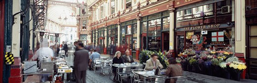 People having lunch at streetside café,  Leadenhall market, London, UK : Stock Photo