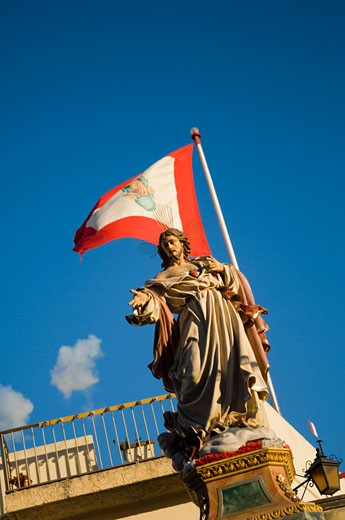 Statue with flag,  Malta : Stock Photo