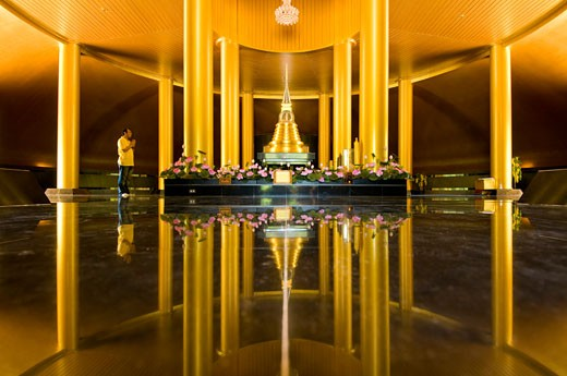 Man praying inside stupa containing the ashes of Ajarn Cha, at Wat Nong Pa Pong,  Ubon Ratchathani, Isan, Thailand : Stock Photo