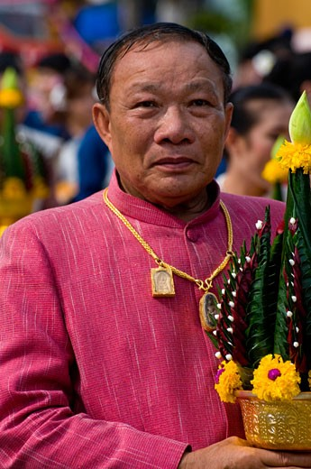 Man holding offering,  Ubon Ratchathani, Thailand : Stock Photo