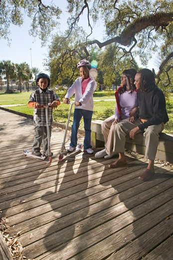 Young African American family outdoors in park : Stock Photo