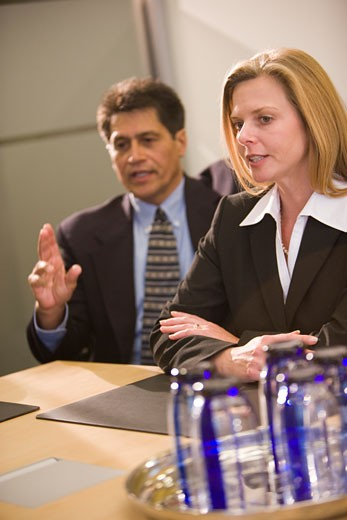 Stock Photo: 1785-10772 Multi-racial businesspeople having discussion in boardroom