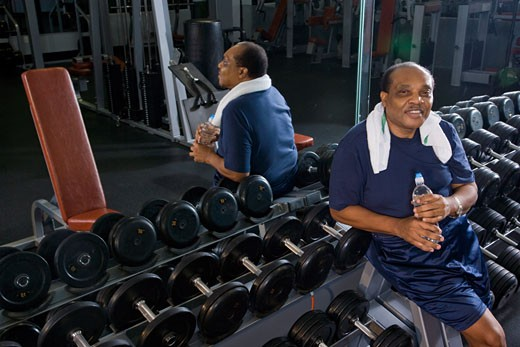 Portrait of senior man working out at gym : Stock Photo