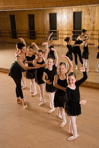 Young ballerinas with dance instructor in studio : Stock Photo