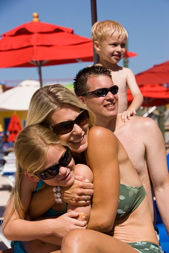 Stock Photo: 1785-12361 Close-up of family on sunny day in swimsuits and sunglasses