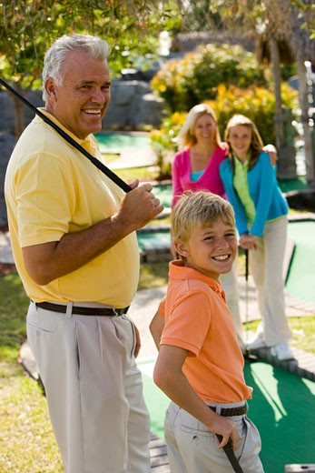 Stock Photo: 1785-12567 Family playing miniature golf