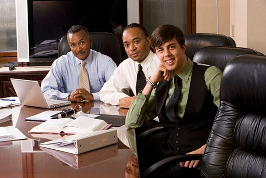 Multi-racial businesssmen working in office conference room on paperwork : Stock Photo