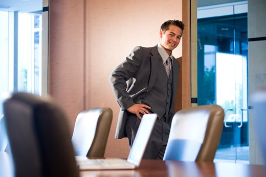 Stock Photo: 1785-14104 Businessman standing in conference room