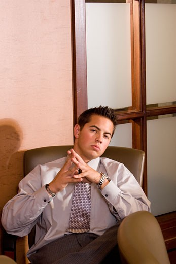 Stock Photo: 1785-14123 Businessman sitting in conference room