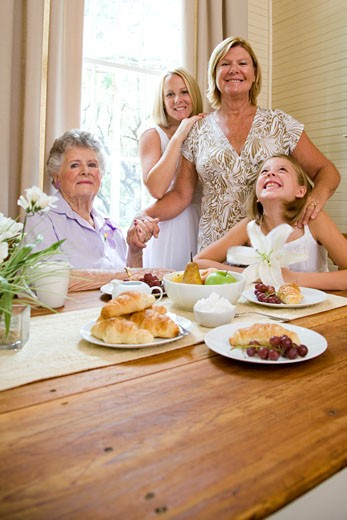 Stock Photo: 1785-14290 Four generations of women at breakfast table
