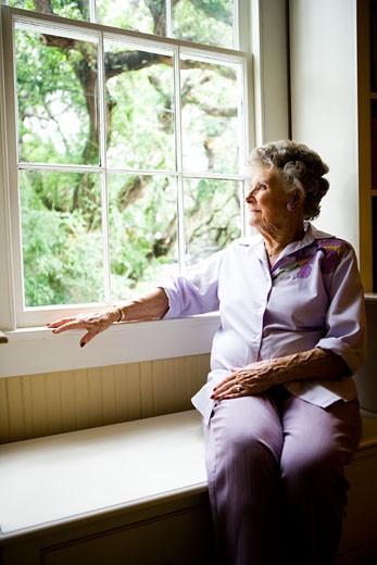 Stock Photo: 1785-14322 Elderly woman sitting by window