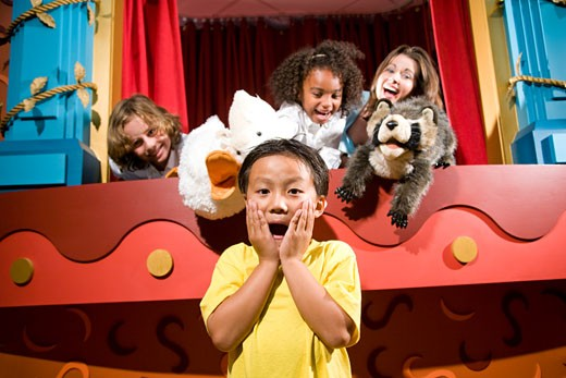 Asian school boy screaming with classmates and teacher in puppet theatre : Stock Photo