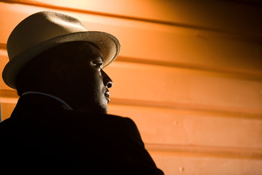 African American man wearing fedora hat : Stock Photo