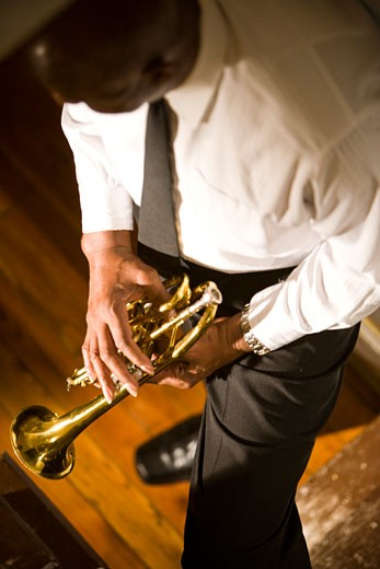 Stock Photo: 1785-14788 High angle view of African American musician holding trumpet in hallway