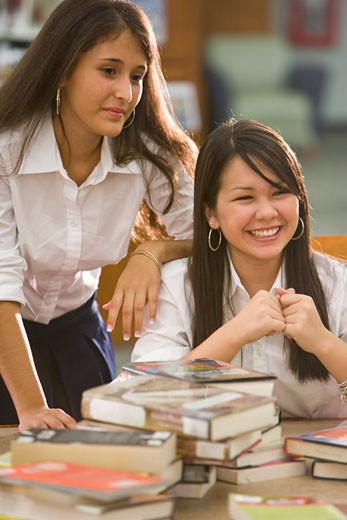 Two high school students in library : Stock Photo
