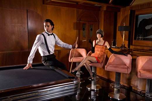 Stock Photo: 1785-17038 Portrait of 1920s socialite couple at billiards table 1920s bar