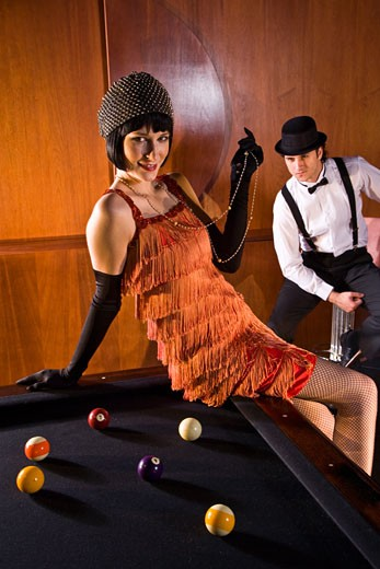 Stock Photo: 1785-17055 Portrait of 1920s socialite couple at billiards table 1920s bar