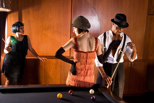 Stock Photo: 1785-17062 African American man playing billiards as woman in flapper dress touches him
