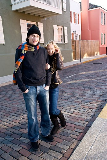 Stock Photo: 1785-17830 Portrait of young couple in warm clothing on cobblestone street