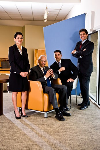 Hispanic business executives in office reception area : Stock Photo