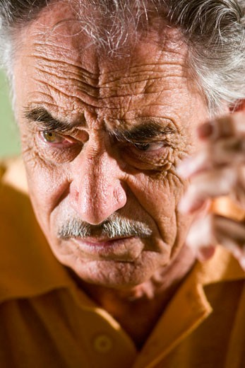 Stock Photo: 1785-19683 Close-up of serious elderly man