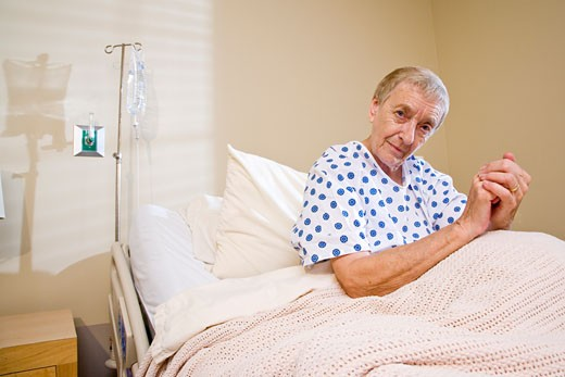 Elderly woman in hospital bed : Stock Photo