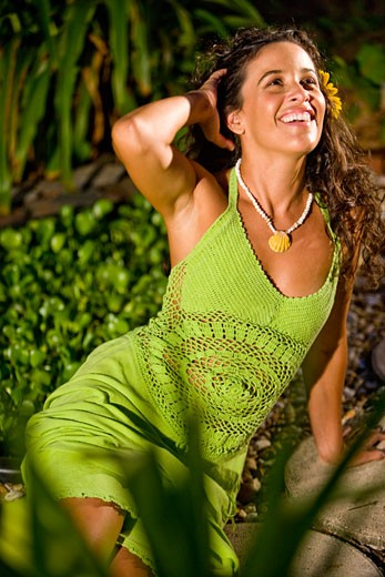Stock Photo: 1785-19846 Young Hispanic woman in green dress on tropical island