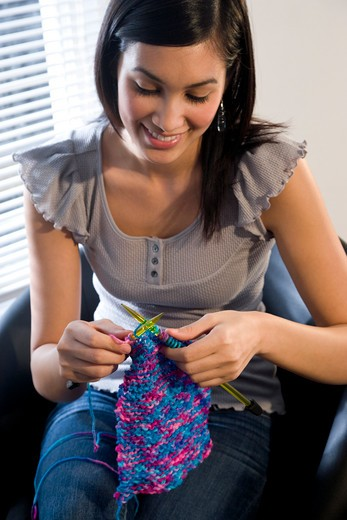 Stock Photo: 1785-39846 Young woman with yarn and knitting needles
