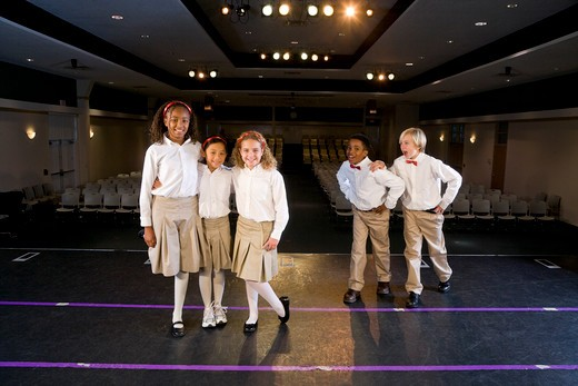 Stock Photo: 1785-39998 Group of school children standing on auditorium stage